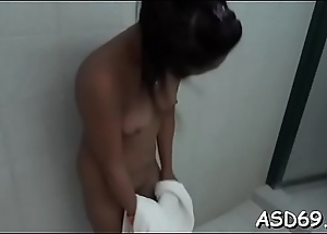 Concupiscent eastern bimbo caresses her wringing wet cunt and gives an oral pursuit