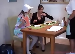 Ma breastfeeds her daughter &amp_ waitress in a restaurant